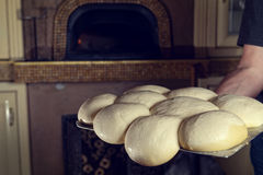 Fresh Italian pizza dough. Fresh original Italian raw pizza dough,  stone oven in background Royalty Free Stock Photos