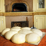 Fresh Italian pizza dough. Fresh original Italian raw pizza dough, stone oven in background Royalty Free Stock Image