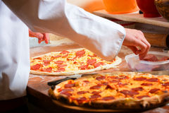Fresh Italian pizza. Fresh original Italian pizza, preparation in traditional style Stock Images