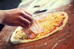 Fresh Italian pizza. Fresh original Italian raw pizza, preparation in traditional style Stock Images