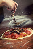 Fresh Italian pizza. Fresh original Italian raw pizza, preparation in traditional style Stock Image