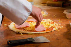 Fresh Italian pizza. Fresh original Italian raw pizza, preparation in traditional style Stock Photo