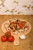 Fresh italian pizza and vegetables Royalty Free Stock Images