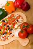 Fresh italian pizza and vegetables Stock Photography