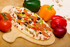 Fresh italian pizza and vegetables Royalty Free Stock Image