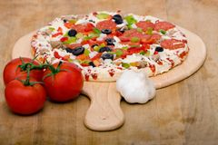 Fresh italian pizza and vegetables Royalty Free Stock Photography