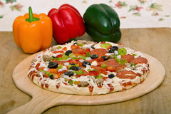 Fresh italian pizza and vegetables royalty free stock photos