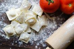 Fresh italian ravioli. Italian home made ravioli in wood board and stick Stock Image