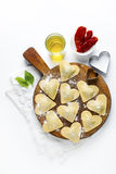 Fresh Italian ravioli in shape of heart. food background. on whi Royalty Free Stock Images