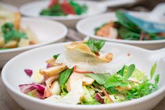 Fresh Italian salad with fish, pesto and lettuce. For lunch or dinner stock photos