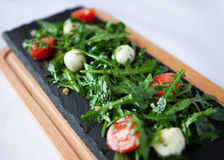 Fresh Italian salad with quail eggs, arugula and tomato with oli Stock Images