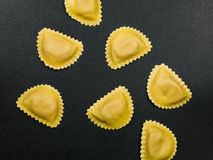 Fresh Italian Style Ravioli Pasta Food. On a Black Background Royalty Free Stock Images