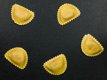 Fresh Italian Style Ravioli Pasta Food. Fresh Healthy Italian Style Ravioli Pasta Food on a Black Background Stock Photo