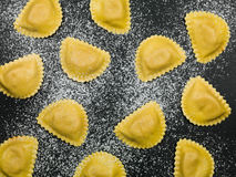 Fresh Italian Style Ravioli Pasta Food. Fresh Healthy Italian Style Ravioli Pasta Food on a Black Background Royalty Free Stock Images