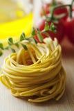 Fresh italian tagliatelle pasta. Fresh tagliatelle with some ingredients Royalty Free Stock Photo