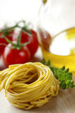 Fresh italian tagliatelle pasta. Fresh tagliatelle with some ingredients Royalty Free Stock Photos