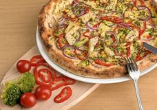 Fresh Italian vegetarian pizza with broccoli and cherry tomatoes. royalty free stock photos