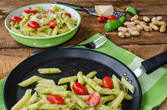 Fresh italien pasta with basil Royalty Free Stock Photography