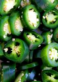 Fresh Jalapeno slices. Fresh green jalapeno peppers in a pile Royalty Free Stock Photography