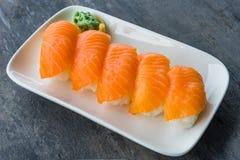 Fresh Japanese Salmon Sushi in white dish with Wasabi Royalty Free Stock Image