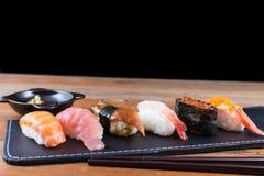 Fresh Japanese sushi. On black background Stock Photos