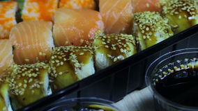 Fresh Japanese sushi and rolls,Macro sashimi, uramaki and nighiri. typical Japanese dish stock footage