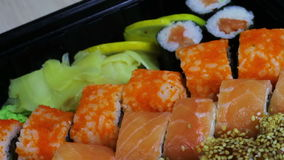 Fresh Japanese sushi and rolls,Macro sashimi, uramaki and nighiri. typical Japanese dish stock video