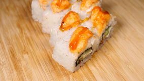 Fresh Japanese sushi and rolls on wooden table. stock video