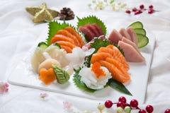 Fresh Japanese Sushi Salmon Platter. Assorted sushi on a  salmon with christmas decor Stock Image
