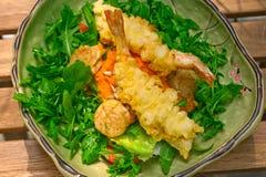 Fresh Japanese tempura shrimps with salad Royalty Free Stock Photos