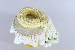 Fresh jasmine garland on tray for Mother Day of Thailand with space for text. Stock Photos