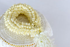 Fresh jasmine garland on tray for Mother Day of Thailand with space for text. Stock Photo