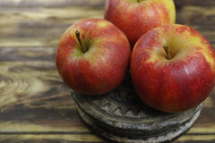 Fresh jonagold apples. On wooden background Stock Photo