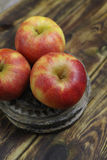 Fresh jonagold apples. On wooden background Royalty Free Stock Photo