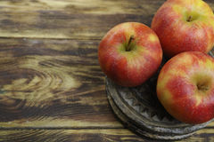 Fresh jonagold apples. On wooden background Royalty Free Stock Photography