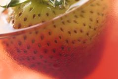 Fresh juice. A glass of fresh juice with a fresh strawberry inside Stock Photo