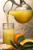 Fresh juice. Pouring fresh orange juice in a glass Stock Photo