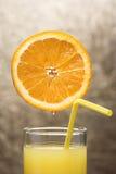 Fresh juice. Glass whit fresh juice and orange on top, close-up Stock Images