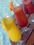 Fresh juice. Three fresh juices on wooden table Royalty Free Stock Photo
