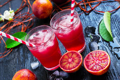 Fresh juice from blood oranges with ice. dark background Royalty Free Stock Image