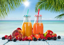 Fresh juice with fruit mix on the beach Stock Photos
