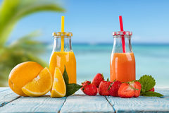 Fresh juice with fruit mix on the beach Stock Image