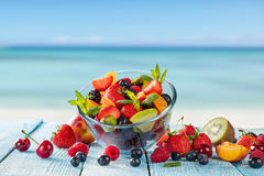Fresh juice with fruit mix on the beach Royalty Free Stock Images