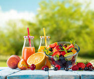 Fresh juice with fruit mix on wooden table Royalty Free Stock Images