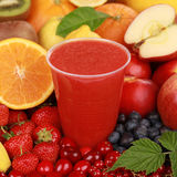 Fresh juice from fruits like oranges, berries and strawberries Stock Image