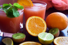 Fresh juice with fruits on table Royalty Free Stock Photography