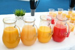Fresh juice jugs Stock Photo