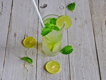 Fresh juice with lime slice on wooden background Royalty Free Stock Image