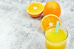 Fresh juice Orange juice in a glass with orange slices on light concrete. horizontal view. detox. close-up. copy space. citrus royalty free stock image