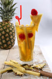 Fresh juice with pineapple slice Royalty Free Stock Photos